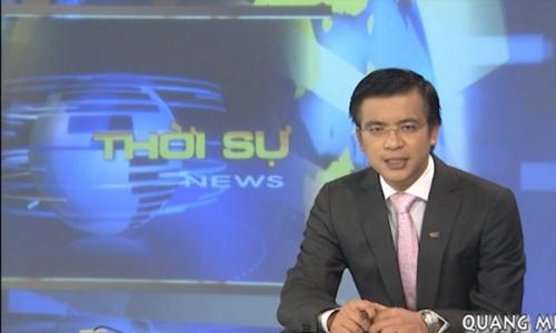 Biên tập viên Quang Minh trong chương trình thời sự 19 giờ.