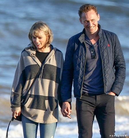 Taylor Swift và Tom Hiddleston vẫn hạnh phúc mặc scandal ồn ào.(Ảnh: Internet)