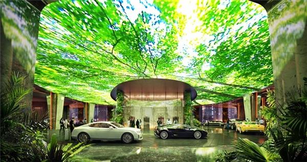 Khu vực sảnh đón khách được bao phủ bởi cây nhiệt đới và mái vòmlà một màn hình lớn.