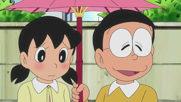 ...hay khi mỉm cườingại ngùng trước Xuka, chúng ta chỉ thấy được một nửa biểu cảm của cậu qua cặp kínhquá dày kia.
