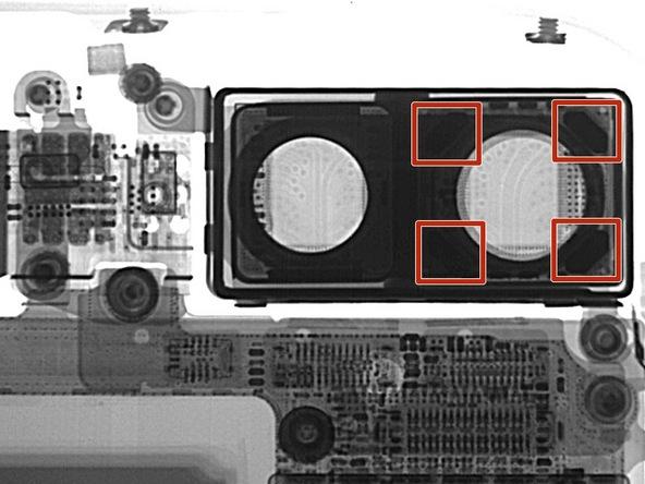 Dùng máy X-quang để chụp ảnh, nhóm iFixit phát hiện 4 thanh nam châm xung quanh camera có tác dụng chống rung quang học.(Ảnh: iFixit)