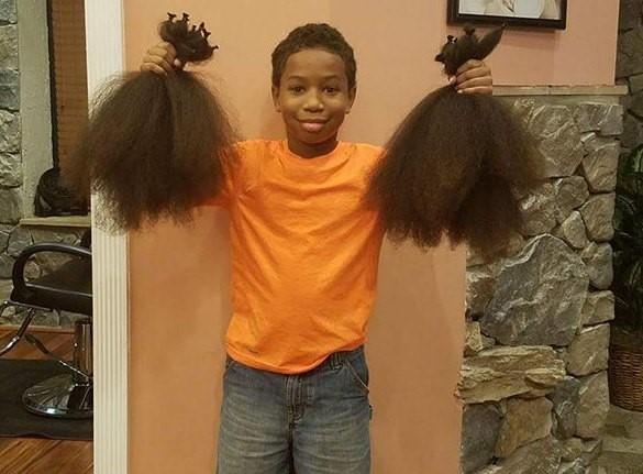 Mái tóc được Thomas nuôi dưỡng suốt 2 năm đã có thể tạo thành 3 bộ tóc giả cho bệnh nhân ung thư.