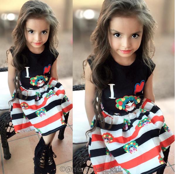 Cô bé có phong cách ăn mặc cực sành điệu.