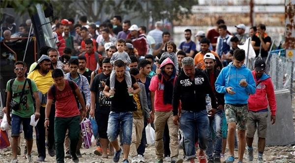 Mỹ losợnhững tên khủng bố sẽ trà trộn vào dòng người tị nạn vào Canada.