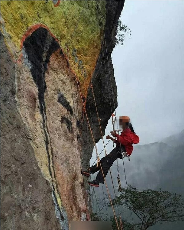 Linh Linhđã vẽ hình ảnh người cô yêu thầm lên vách đá cao.(Ảnh: Internet)