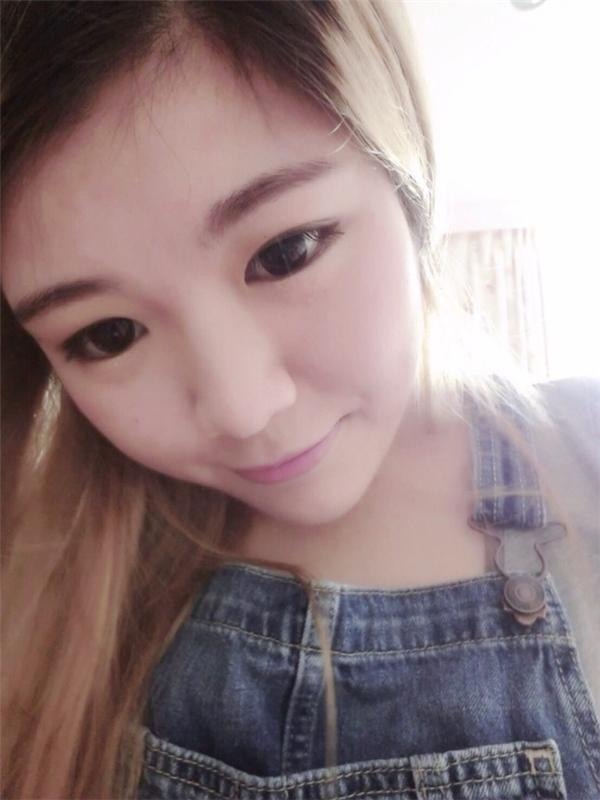 """Nhờ giảm 35kg,Qiu Shuikhông còn là cô gái mập mạp xấu xí như trước mà đã trở thành """"thiên nga"""" vớilàn da trắng trẻo mịn màng, gương mặt trẻ trung xinh đẹp."""
