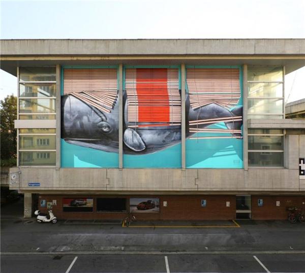 Bức họa này nằm trên một tòa nhà ở Berlin, Đức. (Ảnh: Internet)