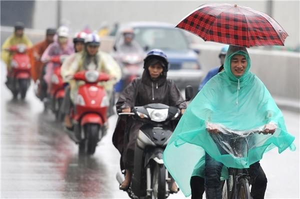 Hà Nội có mưa, mưa rào với nhiệt độ thấp nhất từ 15 - 18 độ C. Trời rét. (Ảnh minh họa).