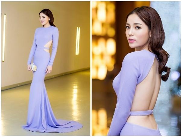 """Kỳ Duyên cũng thử sức cùng các đàn chị khi diện váy đuôi cá kết hợp phần eo được cắt khoét cân xứng. Tuy nhiên, sắc tím tro nhạt lại khiến Hoa hậu Việt Nam 2014 trông """"dừ"""" hơn tuổi thật."""