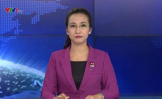 Biên tập viên Vân Anh là gương mặt quen thuộc của bản tin thời sự đài truyền hình Việt Nam.