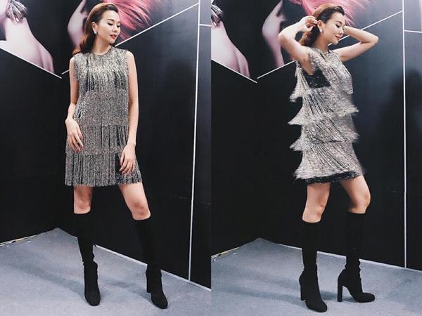 Váy tua rua ánh kim được nữ siêu mẫu phối hợp khéo léo cùng giày boots cổ cao màu đen cổ điển.