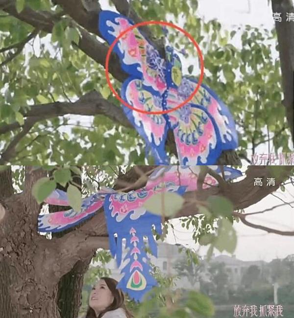 """Con diều bị mắc trên cành cây cao, vì vậy Lệ Vi Vi trèo lên lấy xuống, thế nhưng khi cô vừa tới nơi nó đã """"bay"""" tới một vị trí khác dễ lấy hơn."""