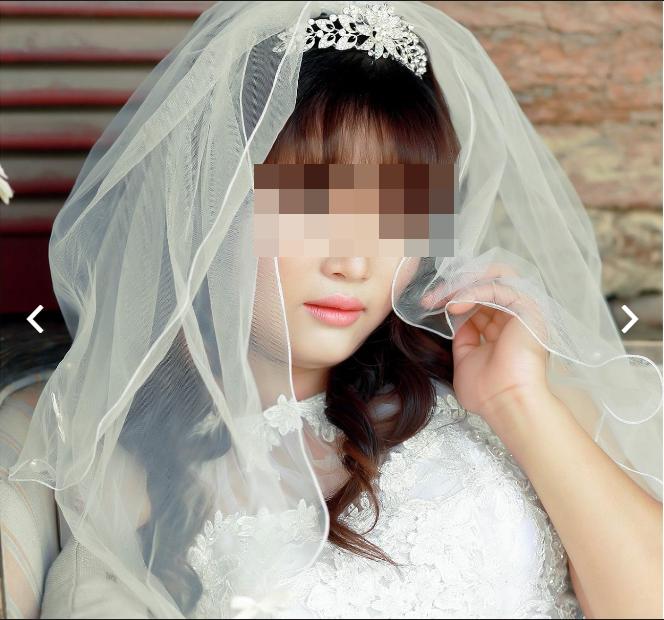 Còn cô dâu thì lại có gương mặt khá ưa nhìn.(Ảnh: Chụp màn hình)