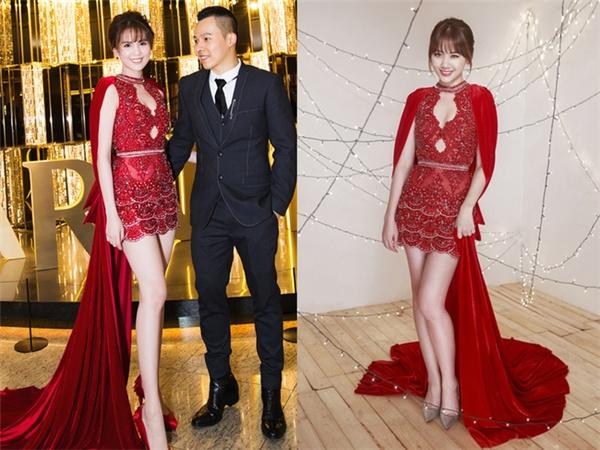 """Trước thềm hôn lễ, Hari Won đã có màn """"đụng hàng"""" gây bão dư luận khi cô diện lại chiếc váy đỏ từng được thiết kế riêng cho Ngọc Trinh. Dù không gợi cảm bằng """"nữ hoàng nội y"""" nhưng sự ngọt ngào, điệu đà của Hari Won đã giúp cô ghi điểm với hình ảnh khác biệt."""