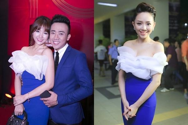 """Màn """"đụng hàng"""" đầu tiên của Hari Won và chắc chắn không thể nào quên trong mắt khán giả chính là với Tóc Tiên. Cùng một bộ váy xanh ôm sát, họa tiết hoa dựng phom 3D sống động, thật khó để phân định ai hơn ai kém."""