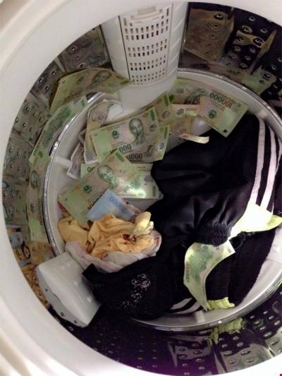 """""""Giặt tiền"""" là không nên đâu.(Ảnh minh họa, nguồn: Internet)"""