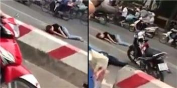 Xót xa thiếu nữ nằm co giật liên tục giữa phố ở Hà Nội