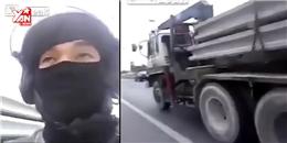 Đau tim với thanh niên chui gầm xe tải để... quay phim