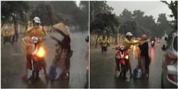 Ấm lòng trước hành động của cô gái Hà thành giữa mưa to gió lớn