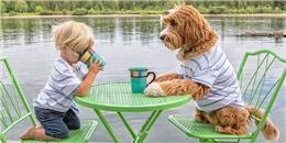 Ngộ nghĩnh hình ảnh cậu bé quấn quít bên chú chó cưng