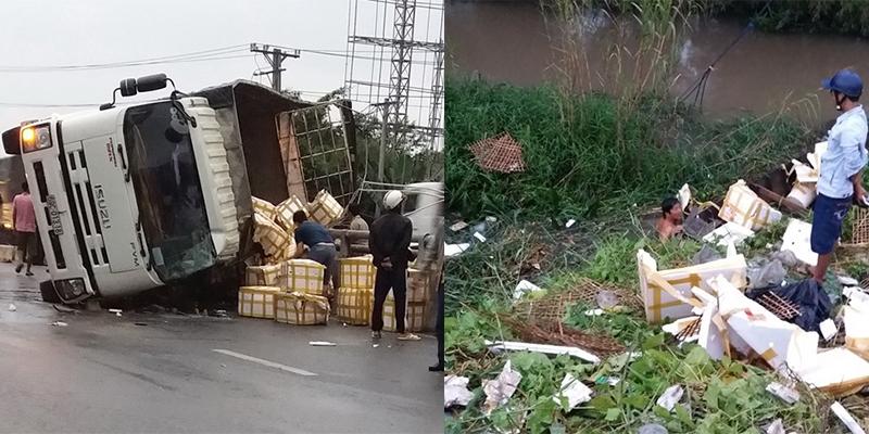 Bất ngờ hành động của người dân trước sự việc xe tải chở cua bị lật