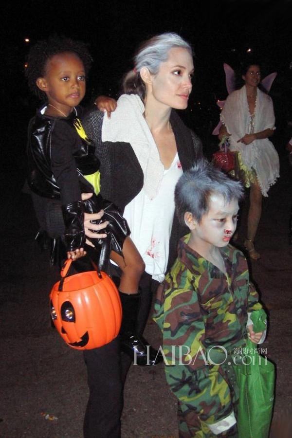 """""""Người đàn bà quyến rũ nhất hành tinh"""" Angelina Jolie chịu khó đi chơi Halloween với hai con Maddox và Zahara."""