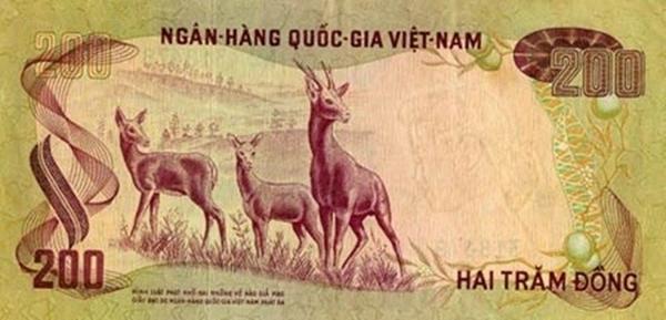"""Tờ bạc 200 với dòng chữ răn đe """"Hình phạt khổ sai những kẻ nào giả mạo giấy bạc do Ngân hàng Quốc gia Việt Nam phát hành ra"""""""