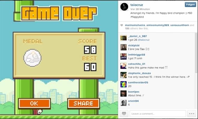 Taio Cruz chia sẽ bức ảnh ghi lại kỷ lục 60 điểm trong trò chơi Flappy Bird.