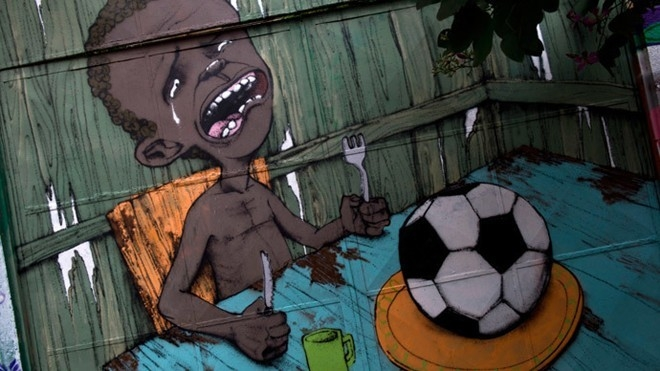 Người dân nghèo Brazil phản đối World Cup thông qua những bức tranh Graffiti. Ảnh: AFP