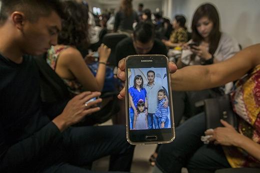 Một thân nhân chia sẻ tấm hình chụp về người thân của họ đã có mặt trên chuyến bay định mệnh này