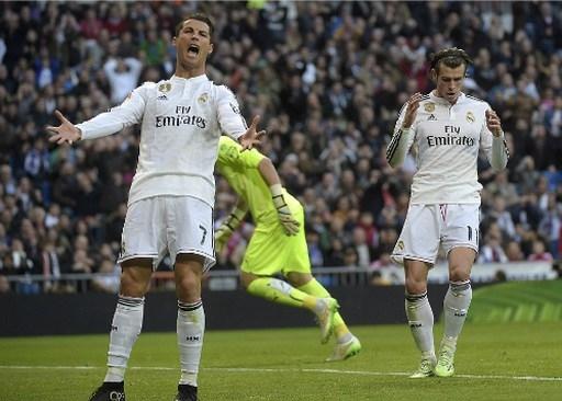 Ronaldo giận dữ trong tình huống Bale không chuyền bóng. Ảnh: AFP.
