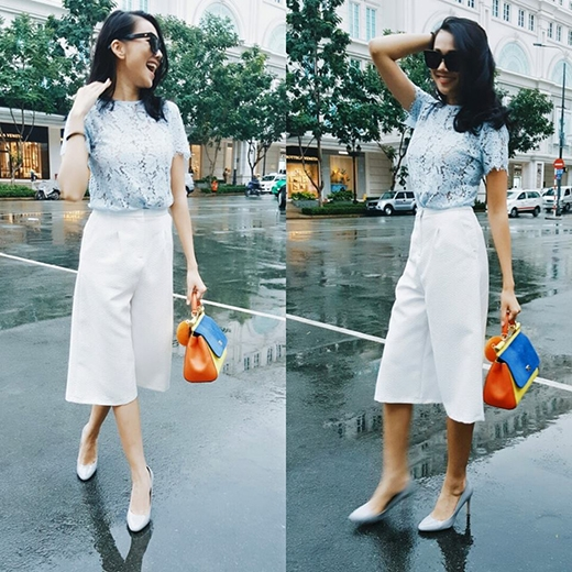 Trái ngược với hình ảnh khá nam tính trên, Thanh Hằng lại nữ tính, điệu đà nhưng không làm mất đi vẻ sang trọng khi lăng xê mốt quần culottes diện cùng áo ren xuyên thấu. Chân dài 1m12 tạo điểm nhấn cho cả cây trắng bằng chiếc túi color block nổi bật.