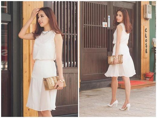 Hoa hậu Mai Phương Thúy diện cả cây trắng kết hợp áo phom rộng cùng chân váy xòe điệu đà, nữ tính. Đây cũng chính là định hướng hình ảnh về sau của Hoa hậu Việt Nam 2006.