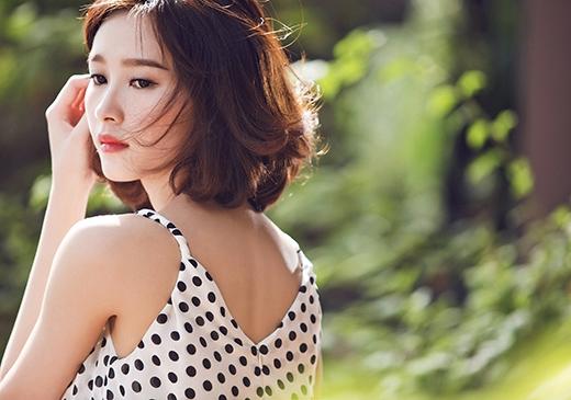 Mái tóc ngắn trẻ trung, cá tính nhưng vẫn nhẹ nhàng của Hoa hậu Việt Nam 2012.