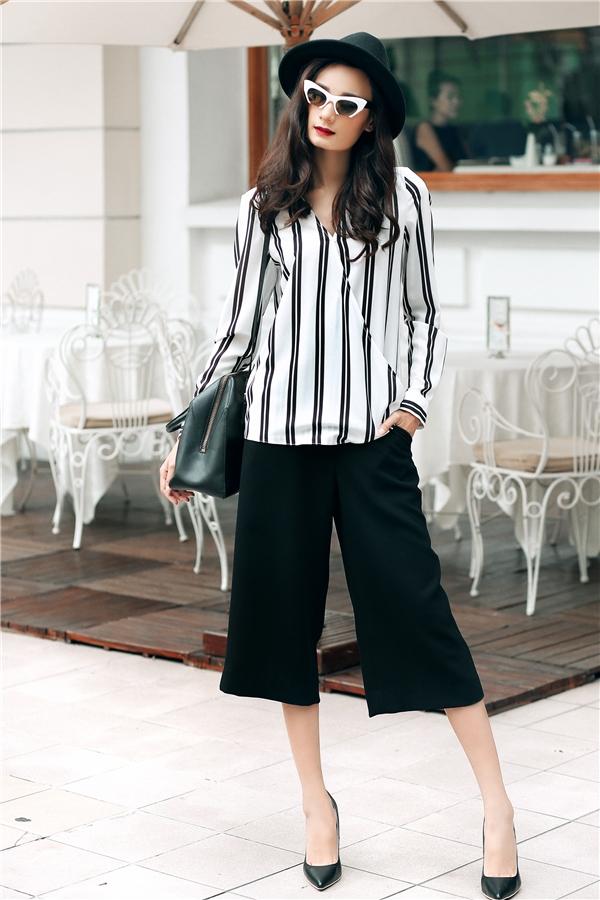 Lê Thúy dạo phố với trang phục trắng, đen đầy mê hoặc