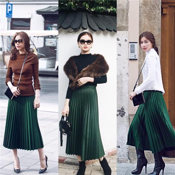 Diễm Trang trổ tài phối trang phục khéo léo với cùng một kiểu chân váy xếp li màu xanh cổ vịt hợp mốt trong mùa thời trang Thu - Đông.