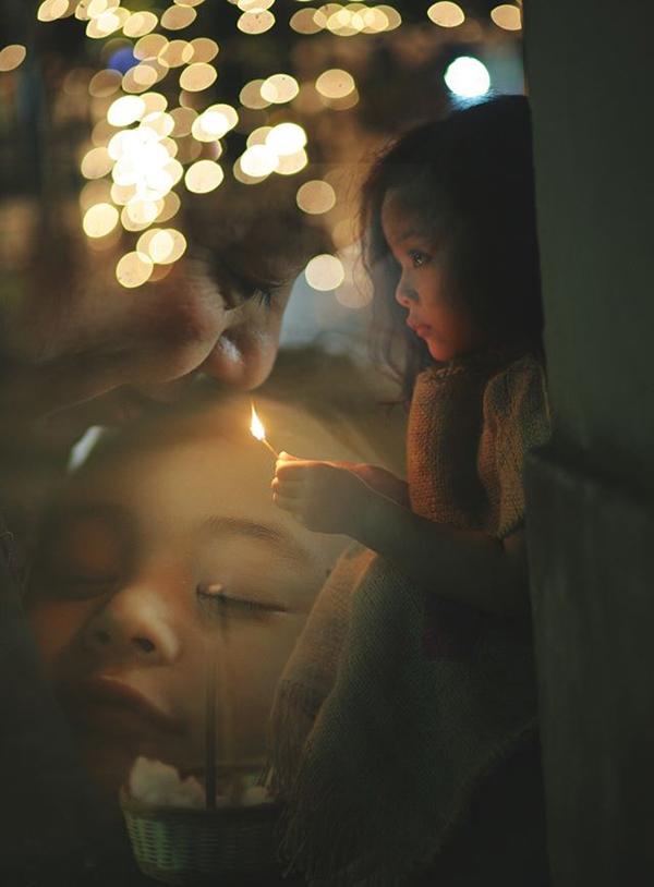 Que diêm được thắp sáng, cô bé ước mơ được ngủ ngon trong vòng tay yêu thương của người thân. (Ảnh: Internet)
