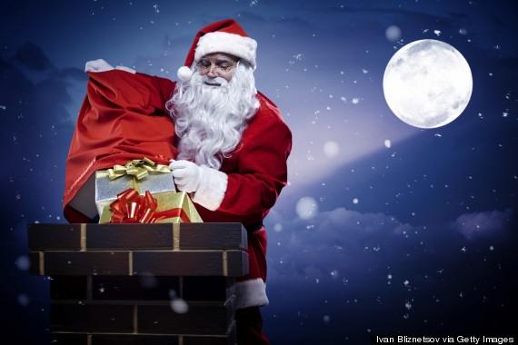 Ông già Noel tặng quà qua ống khói (Ảnh: Getty Images)