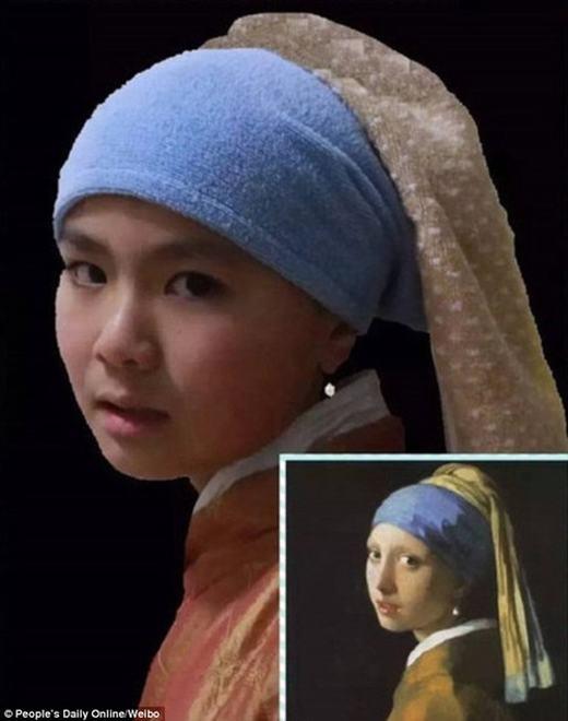 """Bức tranh """"Cô gái đeo hoa tai ngọc trai"""" của danh họa Vermeer được tái hiện khá dễ thương. (Ảnh:China Daily)"""