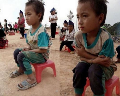 Bức ảnh về bé trai này khiến bất cứ ai cũng cảm thấy nhói lòng (Ảnh: Bùi Sơn).