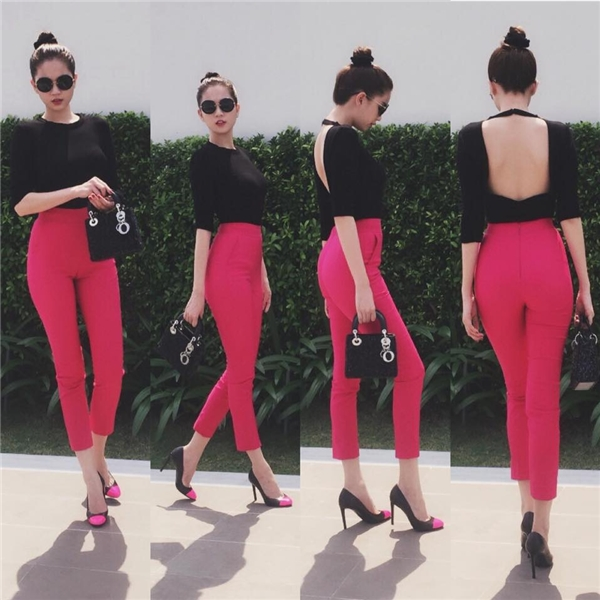 Ngọc Trinh đơn giản nhưng vẫn vô cùng gợi cảm với áo khoét lưng diện cùng quần legging. Tổng thể trông khá bắt mắt bởi sự cân bằng giữa sáng tối, đậm nhạt với hai tông màu hồng, đen.