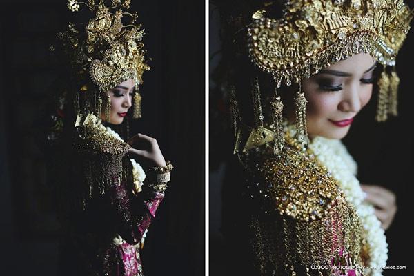 Cô dâu với gương mặt bầu bĩnh phúc hậu, được trang điểm cầu kì như các quý phi chuẩn bị nhập cung. (Ảnh: Internet)
