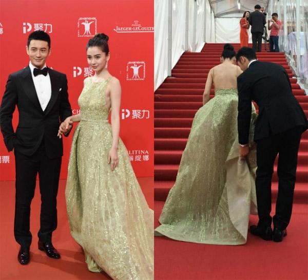 Huỳnh Hiểu Minh cùng những hành động lãng mạn với vợ khiến đám đông hò reo khi hai người xuất hiện. Ảnh: Sina.