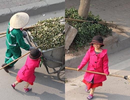 Hình ảnh chị nhân viên môi trường cùng con gái làm việc.