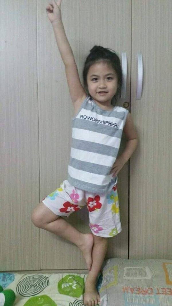 Cận mặt cô bé 6 tuổiTan Xin Xiubị mất tích không rõ thông tin.(Nguồn: Internet)