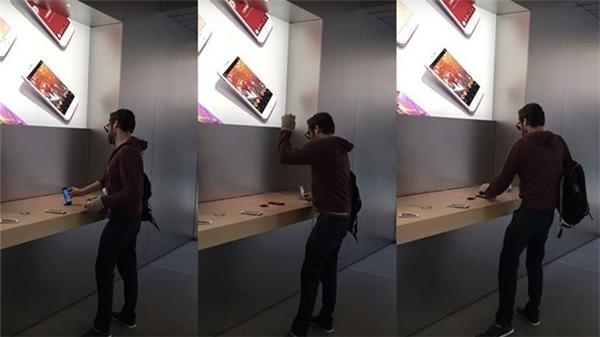 Ngang nhiên đập vỡ từng chiếc iPhone trong cửa hàng. (Ảnh: internet)