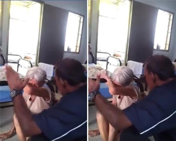 Như một thói quen, cụ bà đưa tay lên che mặt trước khi người đàn ông bạt tai cụ.