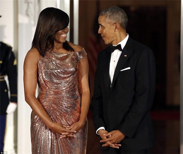 Tổng thống Barack Obama và Đệ nhất Phu nhân Michelle Obama trong buổi quốc yếnthiết đãi Thủ tướng Italy Matteo Renzi và phu nhân Agnese Landini. (Ảnh: AP)