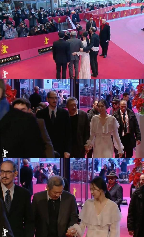 Trong suốt quá trình di chuyển trên thảm đỏ, cặp đôi không ngần ngại thể hiện cử chỉ thân mật như khoác eo, nắm tay...
